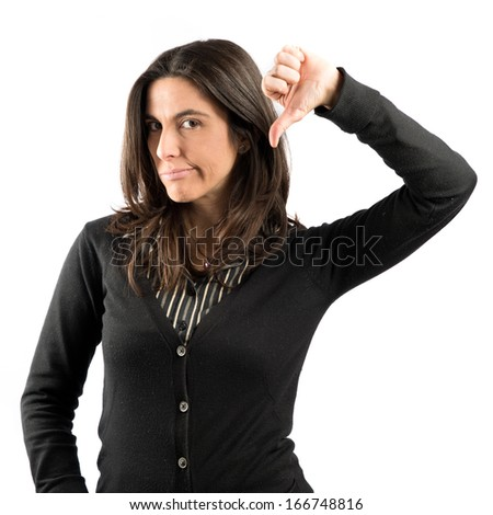 Adult girl doing a bad signal over white background  - stock photo