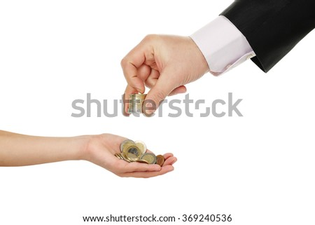 adult giving coins to a boy isolated on white