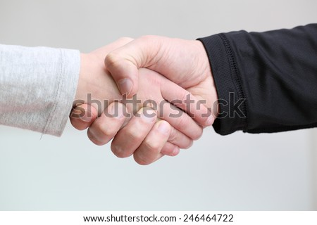 adult handshake father and little daughter - stock photo