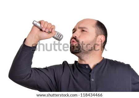 adult handsome man singing on a white background - stock photo