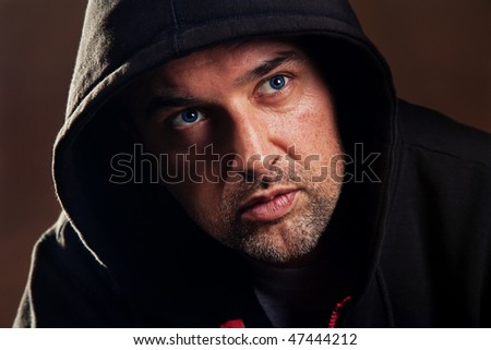 adult handsome man with hood portrait, studio shot