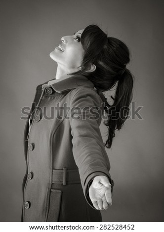 Adult indian woman in studio isolated on grey background, black and white image - stock photo