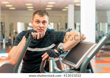 Adult male athlete spends time at the gym