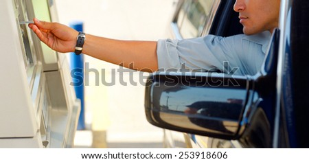 Adult male hand putting money in a parking meter - stock photo