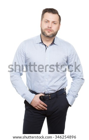adult male with a beard. isolated on white background. Body language. non-verbal cues. training managers. agents. sexual aggression. hand on the belt. focus on the genitals. - stock photo