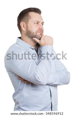 adult male with a beard. isolated on white background. Body language. non-verbal cues. training managers. touch to face. finger under his chin.