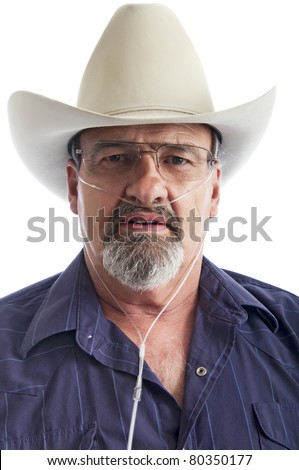 Adult male with a breathing disability, wearing an Oxygen cannula. - stock photo
