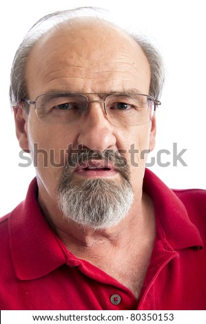 Adult male with a stern look on his face - stock photo