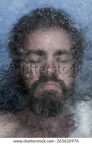 Adult male with beard frozen beneath the ice