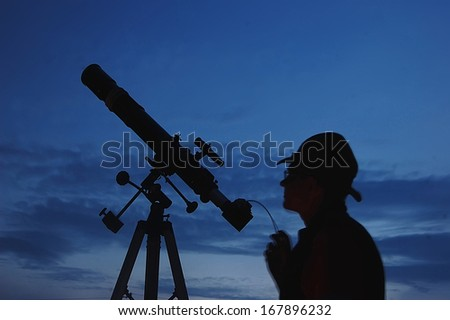 Adult man and telescope with camera. Near Kiev,Ukraine - stock photo