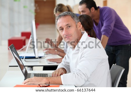 Adult man attending business training - stock photo