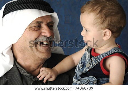 adult man  holding a young baby - stock photo