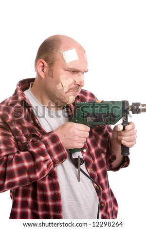 Adult man looking very determined while holding the drill, his head covered in bandaids - stock photo