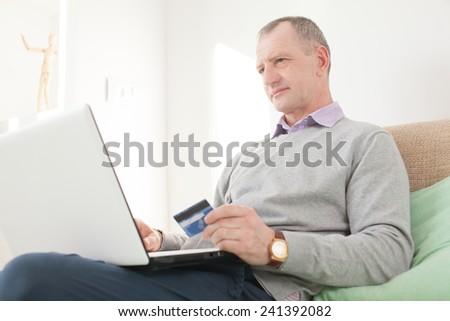 Adult man making online buying - stock photo