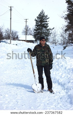Adult man remove  snow.Near Kiev,Ukraine