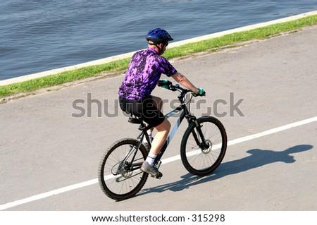 adult man riding on mountain bike - stock photo