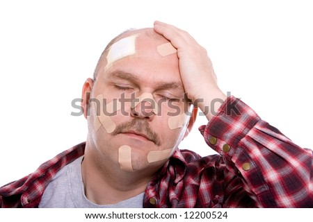 Adult man with his head covered in band aids - stock photo