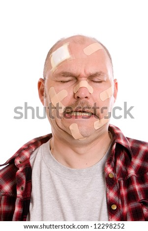 Adult man with his head filled with bandaids, crying