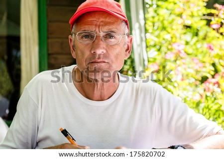 Adult man writing in the garden - stock photo