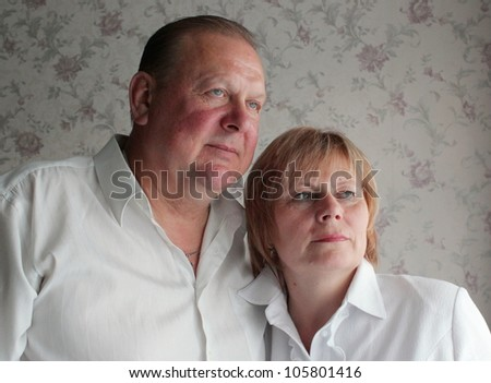 Adult married couple embrace - stock photo