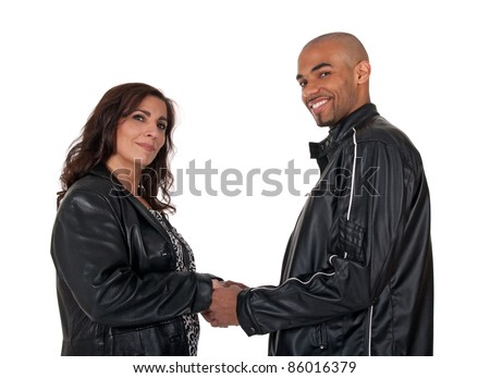 Adult multicultural couple holding hands. Mature woman with younger man. - stock photo
