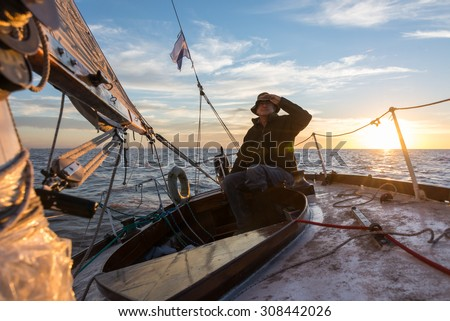 Adult relaxing leisure activity. Sailing South America. - stock photo