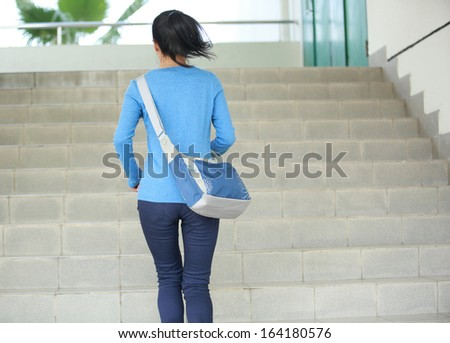 adult student running at stairs in campus - stock photo
