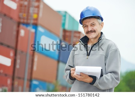 adult terminal cargo dock warehouse worker in front of container
