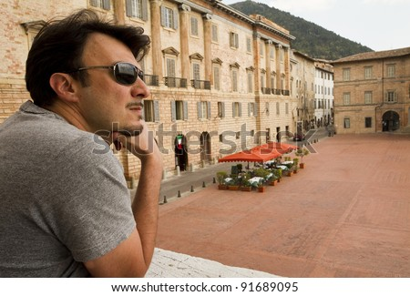 Adult Tourist Visiting Towns in Tuscany and Umbria, Italy