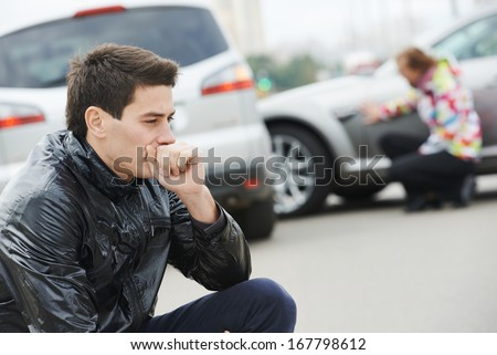 Adult upset driver man in front of automobile crash car collision accident in city - stock photo