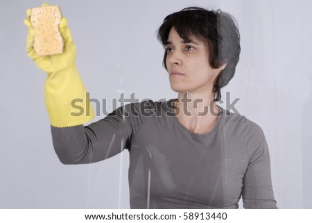 Adult woman cleaning the windows - stock photo