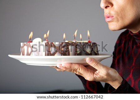 adult woman hands holding a chocolate cake - stock photo