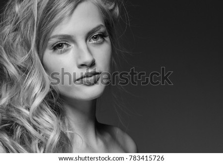 Adult woman portrait, skin care concept, beautiful skin over gray background. Studio shot.Black and white.
