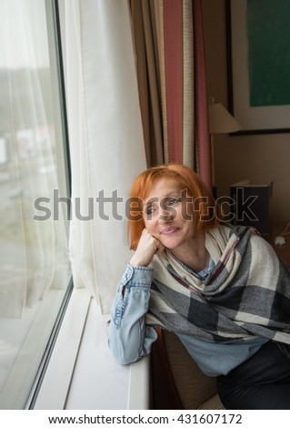 Adult woman thinking and smiling