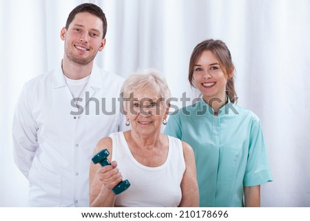 Adult woman training in hospital with her physiotherapists