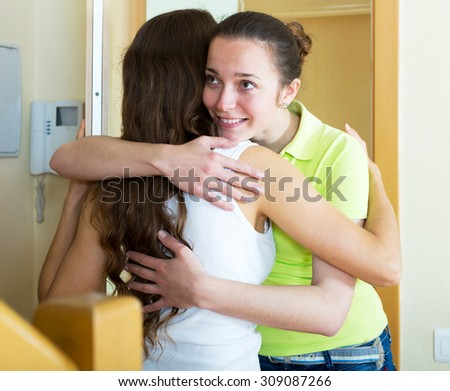 Adult woman visiting her sister in her home