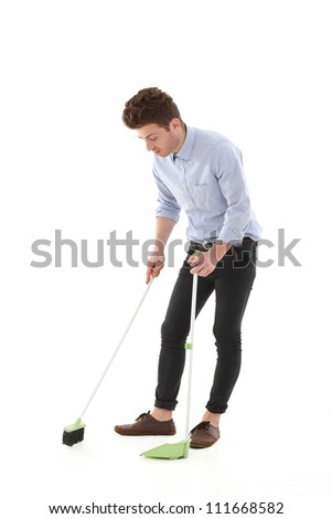 Adult young man singing while cleaning the floor - stock photo