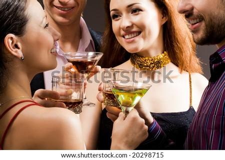 Adults enjoy alcoholic beverages - stock photo