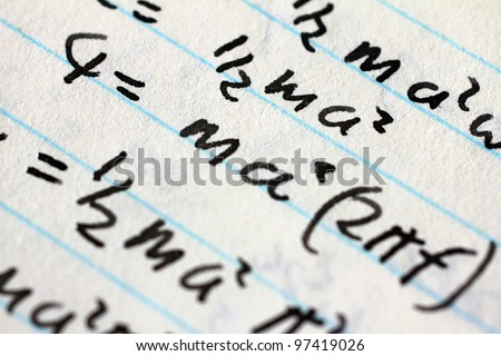 Advanced mathematical equations scribbled in black ink on a white piece of paper - stock photo