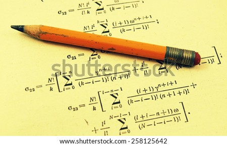 Advanced mathematics (maths): book and pencil in vintage style. - stock photo