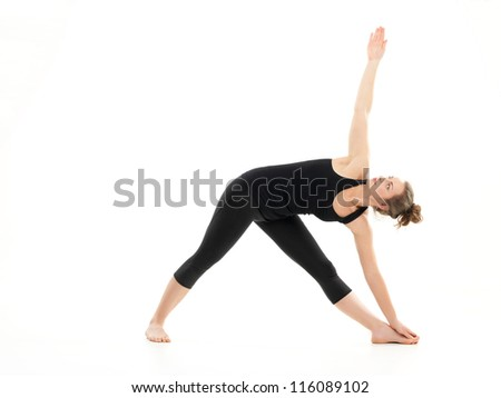 advanced yoga posture, demonstrated by bloden girl, dressed in black, on white background - stock photo