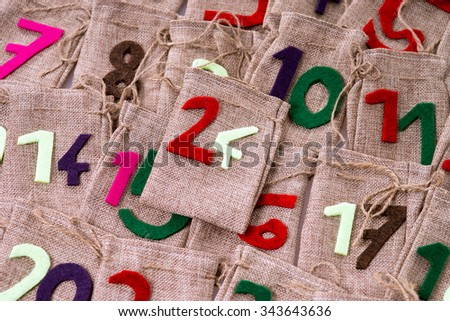 Advent Calendar of twenty four burlap sacks / Christmas time - stock photo