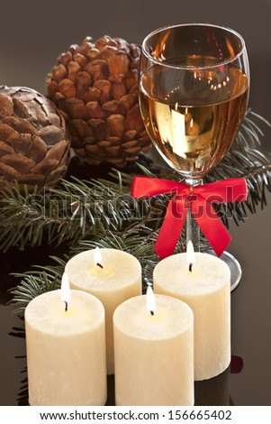 Advent candles with a glass of wine - stock photo