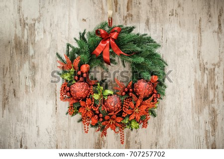 Advent close up Christmas wreath on wooden door decoration