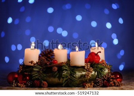 Advent decoration wreath with four burning candles. Christmas background.