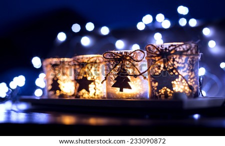 Advent, four candles decorated Christmas tree on a background of lights in exterior