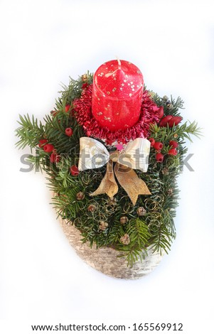 advent spray on slice of tree with red candle, golden ribbon and jew branch with berries - stock photo