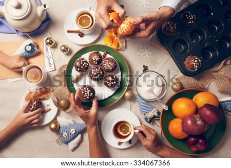 Advent time. Family tea party with homemade muffins - stock photo