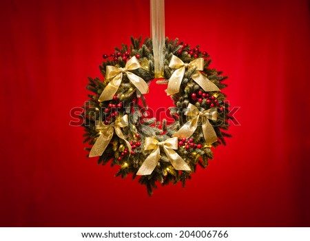 Advent wreath over red background with gold ribbon - stock photo
