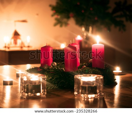 Advent wreath with burning candle - stock photo